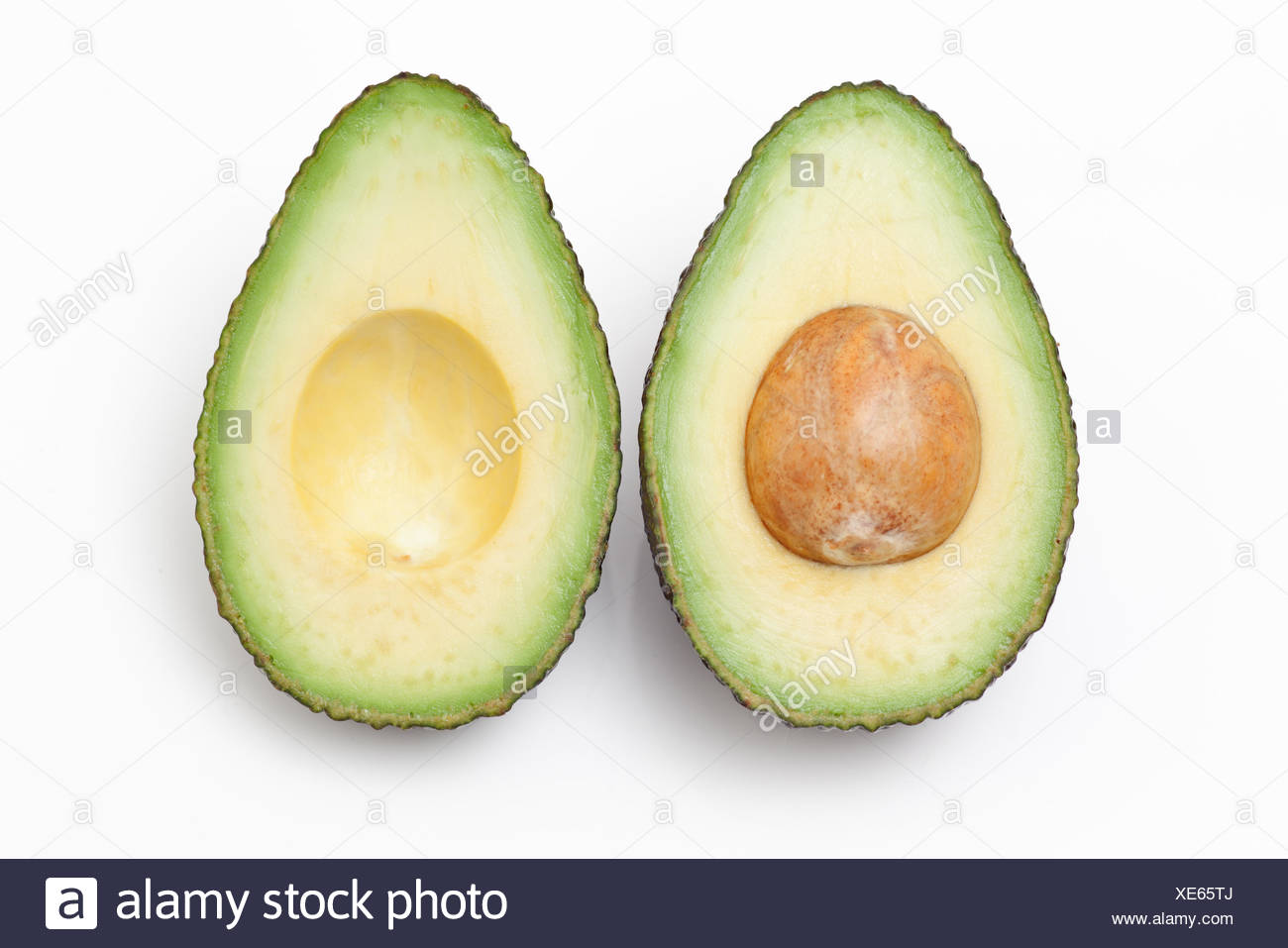 Close up of an Avocado cut in half - Stock Image