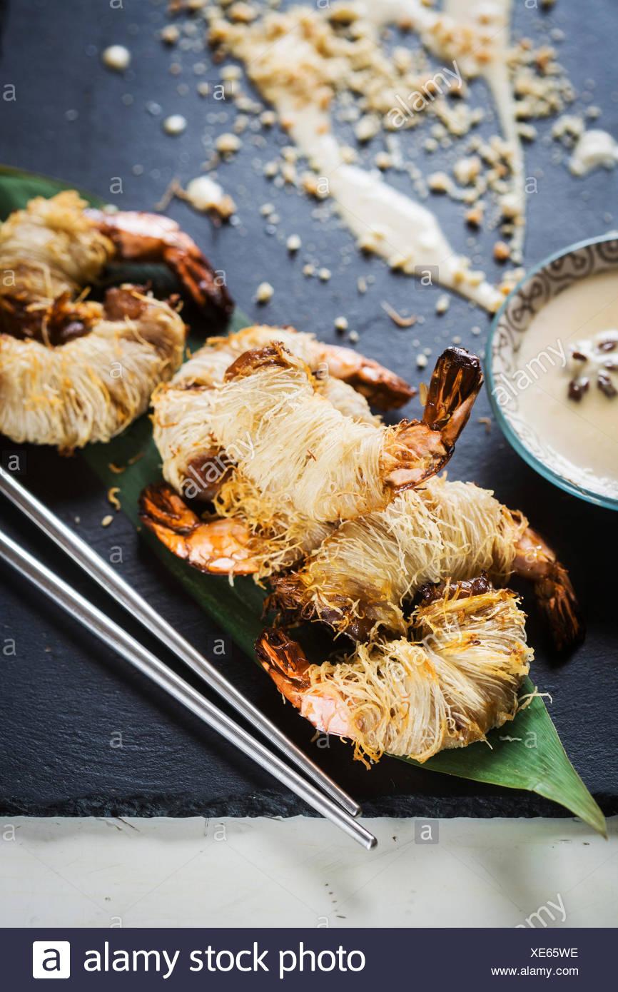 Asian dish - shrimp in hairy dough - Stock Image
