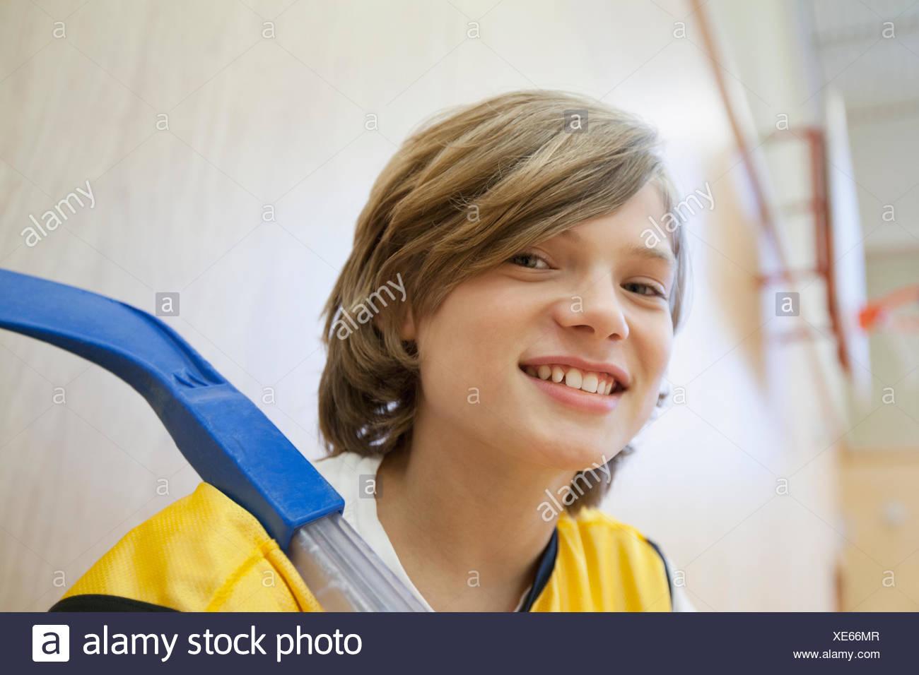 Portrait of male, floor hockey player. - Stock Image