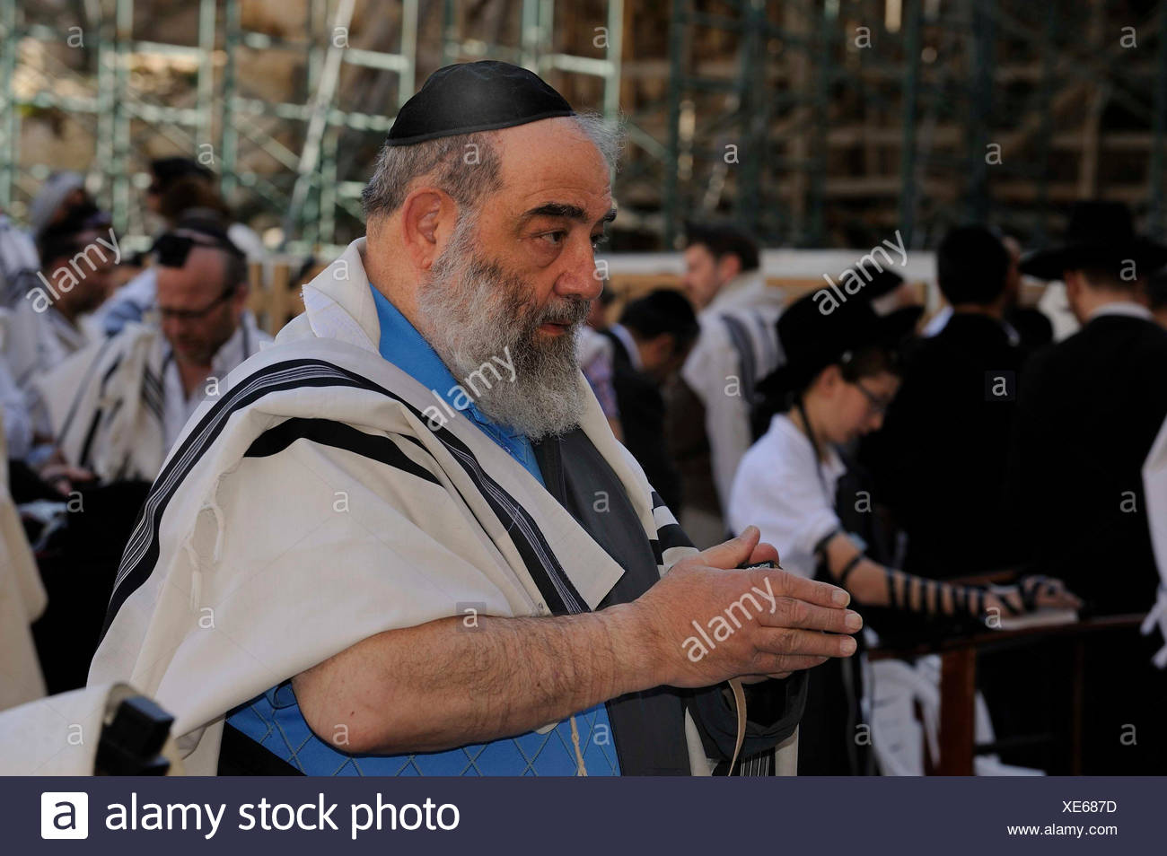 Praying Jew at the Wailing Wall or Western Wall, with kippah and tallin, prayer shawl, over his shoulders, Muslim Quarter - Stock Image