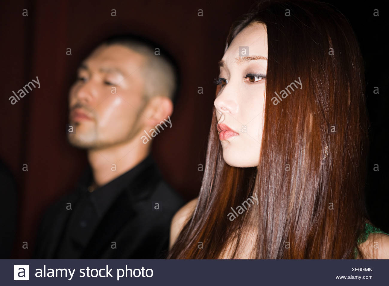 Serious young japanese couple - Stock Image