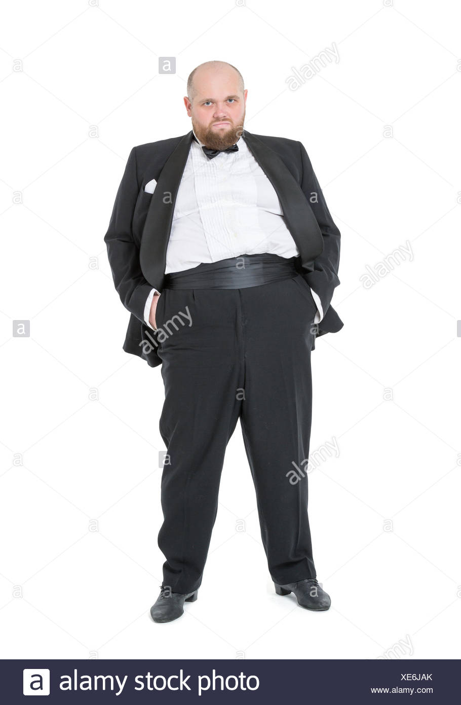 Jolly Fat Man in Tuxedo and Bow tie Shows Emotions - Stock Image