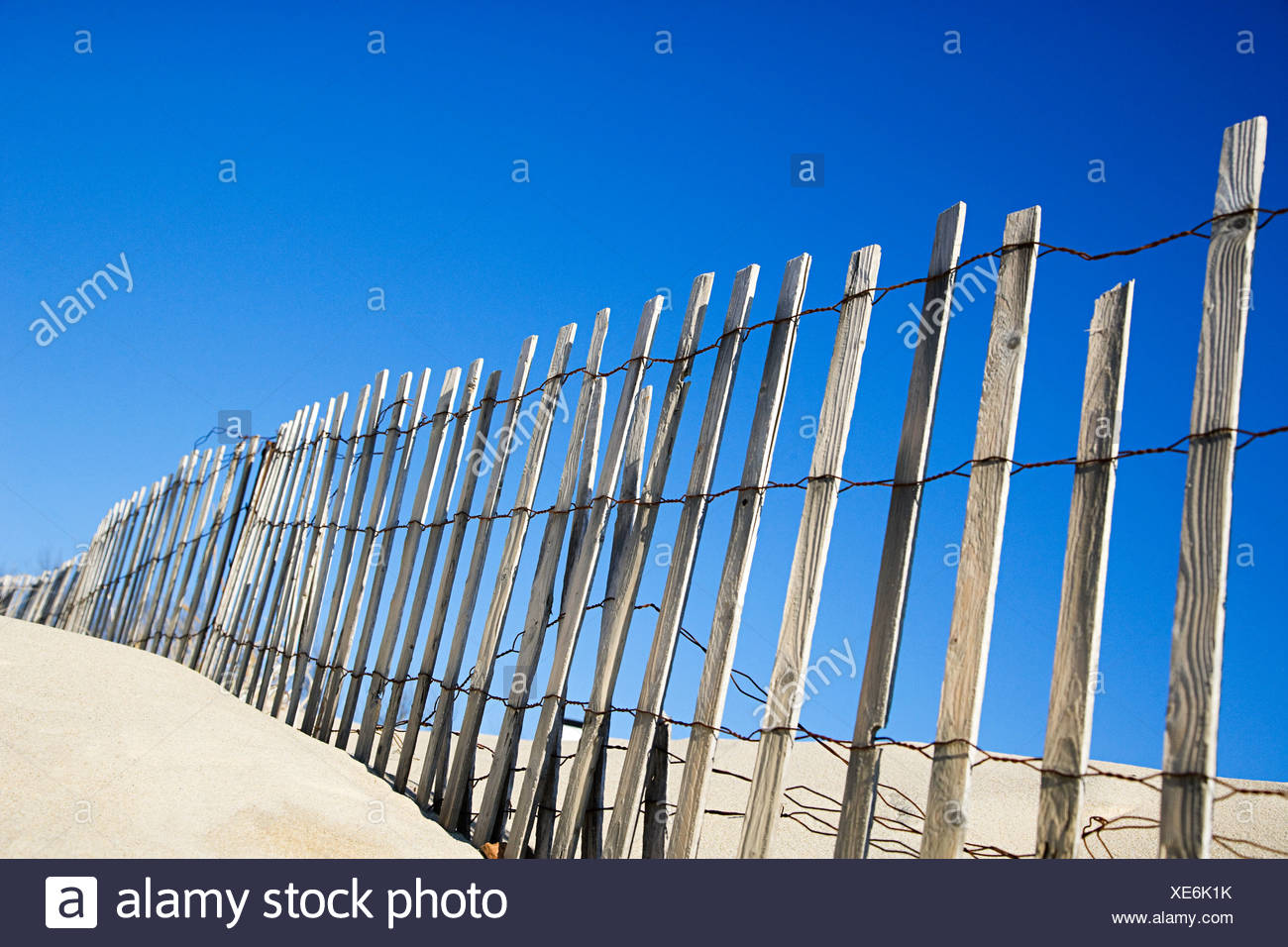 Wooden fence on a beach Stock Photo