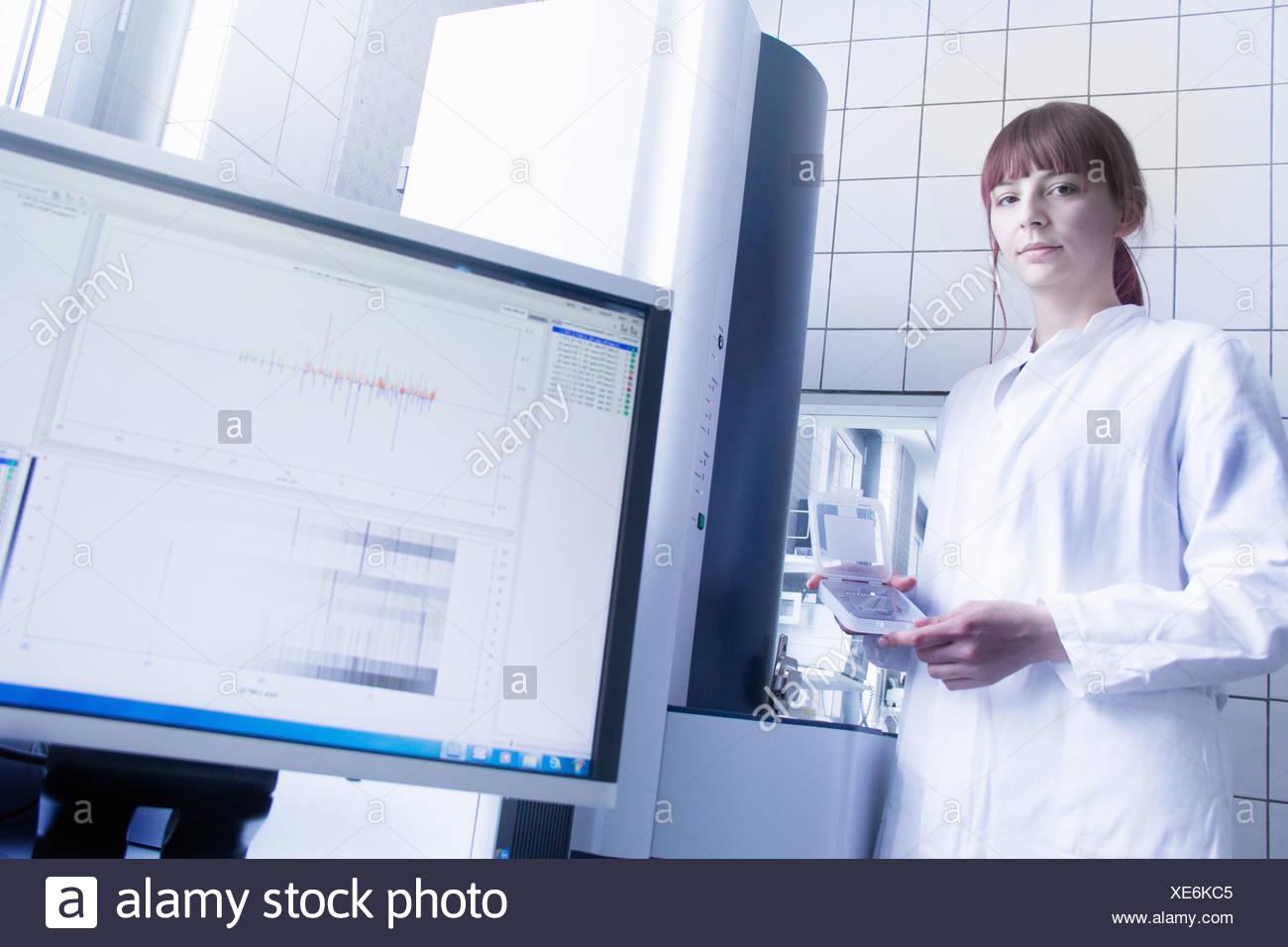 Scientist using equipment in lab Stock Photo
