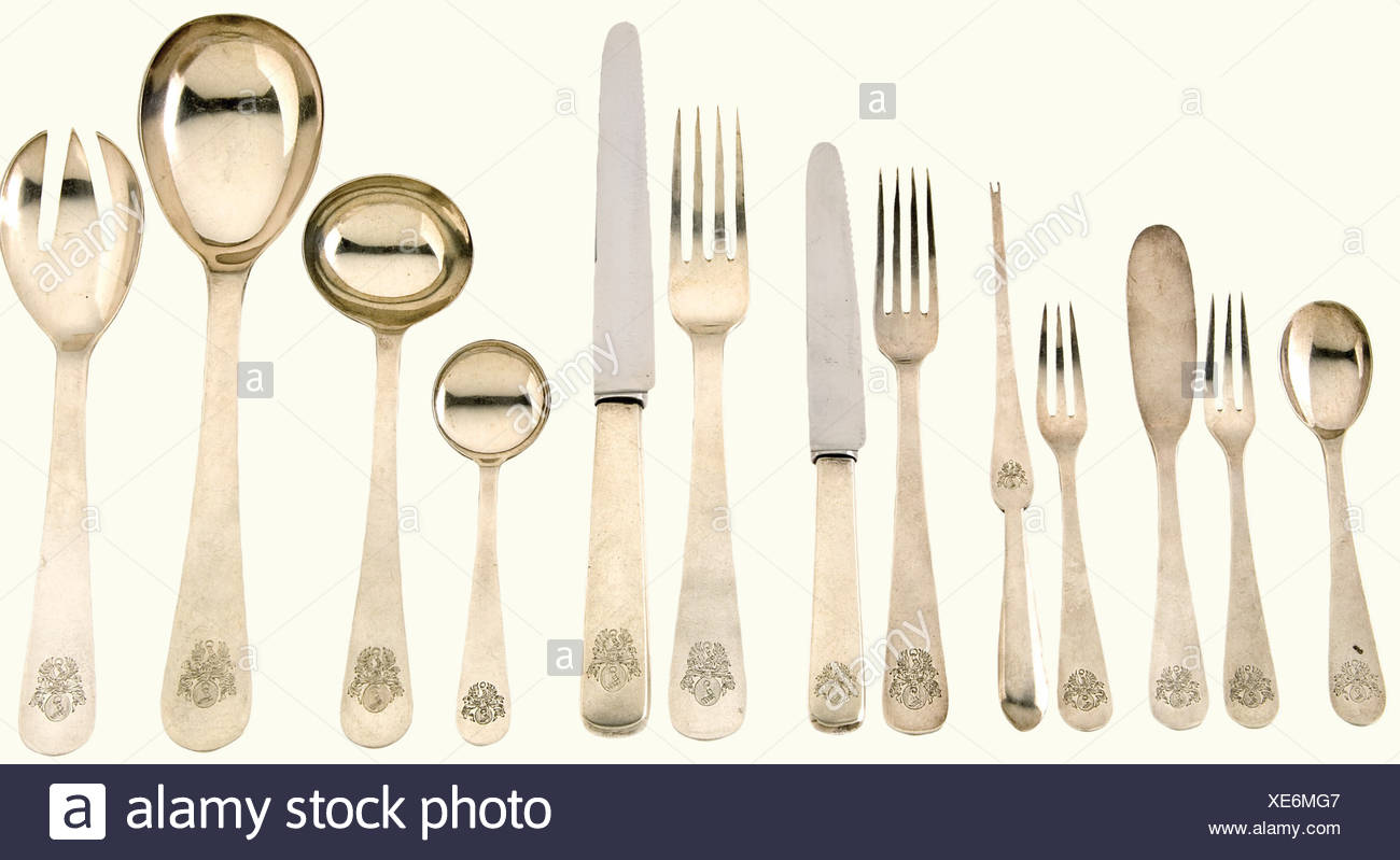 Hermann Göring - 23 pieces from his table silver., Each piece bears the Göring coat of arms, the maker's mark 'JAW', and the hallmark. Four forks, a dessert fork, three pastry forks, four knives, two dessert knives, a butter knife, three tea spoons, one jam spoon, one small and one large ladle, one salad fork, and one lobster fork. Ca. 1600 grams. historic, historical, 1930s, 1930s, 20th century, NS, National Socialism, Nazism, Third Reich, German Reich, Germany, German, National Socialist, Nazi, Nazi period, fascism, cutlery, sets of cutlery, knife, knives, to, Additional-Rights-Clearances-NA - Stock Image