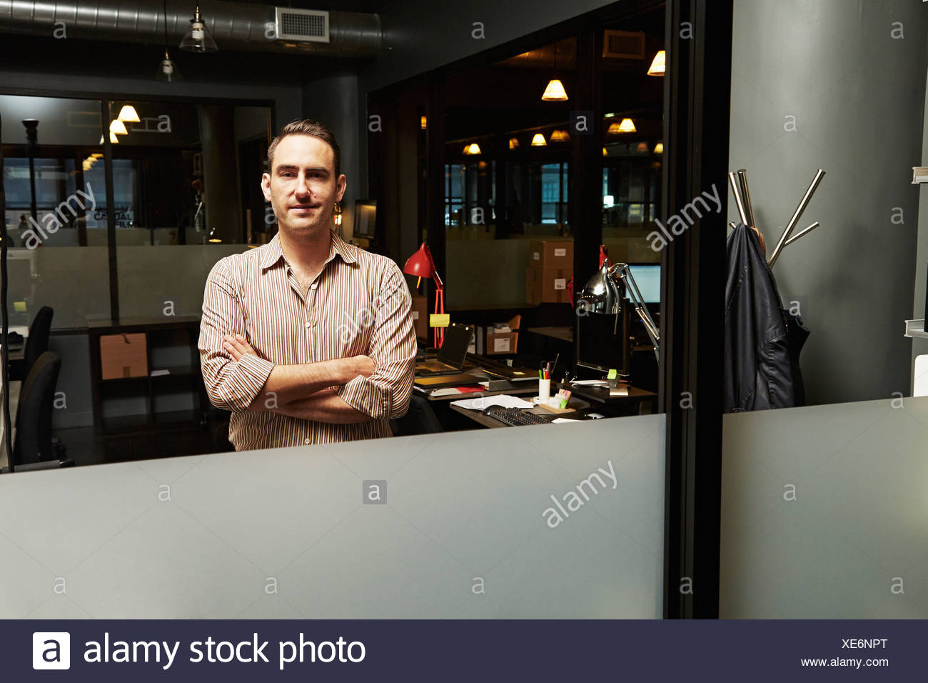 Portrait of businessman with arms folded - Stock Image