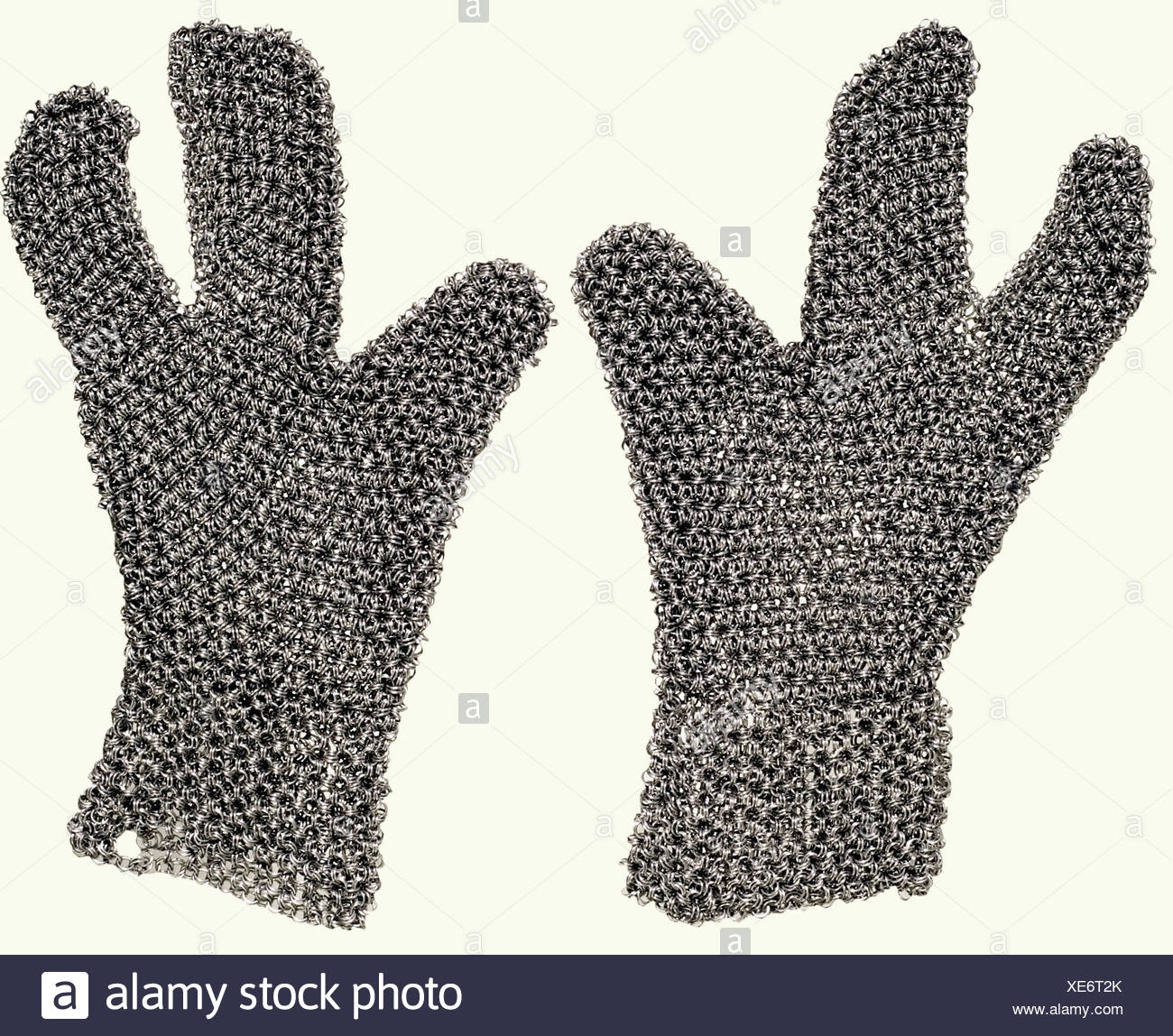 A set of chain mail, Southern Caucasus, 1st half of the 19th century. Hauberk, coif, and gloves, made of mail of different strengths. The rings are not riveted, and in the oriental fashion are always hung on six sides of a central double ring. Short shirt with long sleeves of extremely heavy mail. The interior of the sleeve has been lightly worked. The lower edge is scalloped. Isolated defects. The coif has a heavy calotte and lighter sides and collar. Three-fingered gloves. Length of the hauberk, ca. 68 cm. Extremely high quality workmanship on the hauberk, wh, Additional-Rights-Clearances-NA - Stock Image