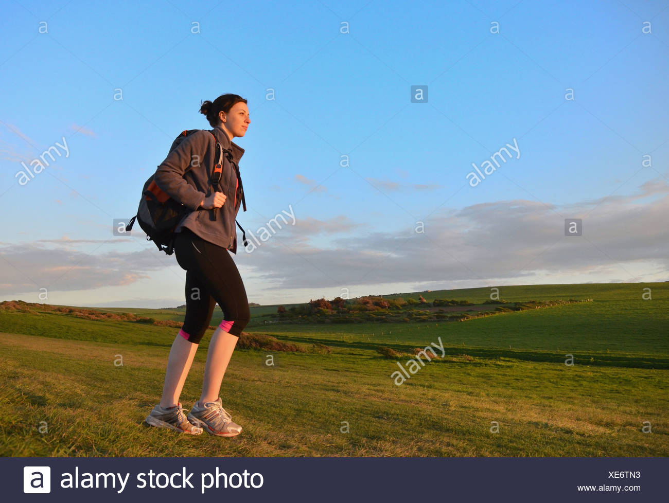 Young female hiker, hiking in hills - Stock Image