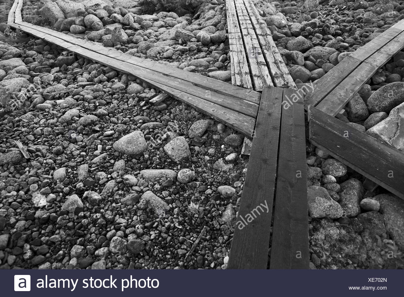 Overhead view of planks and pebbles - Stock Image