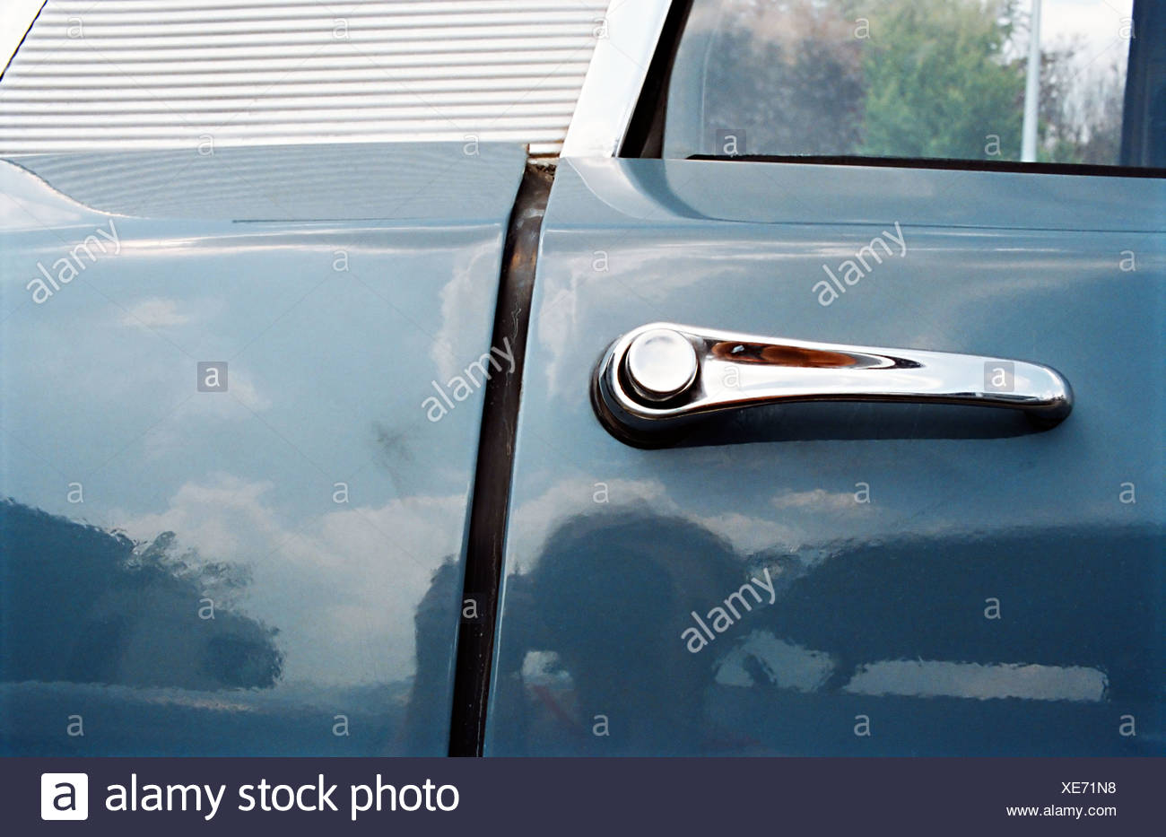 Close-up of vintage car door handle - Stock Image