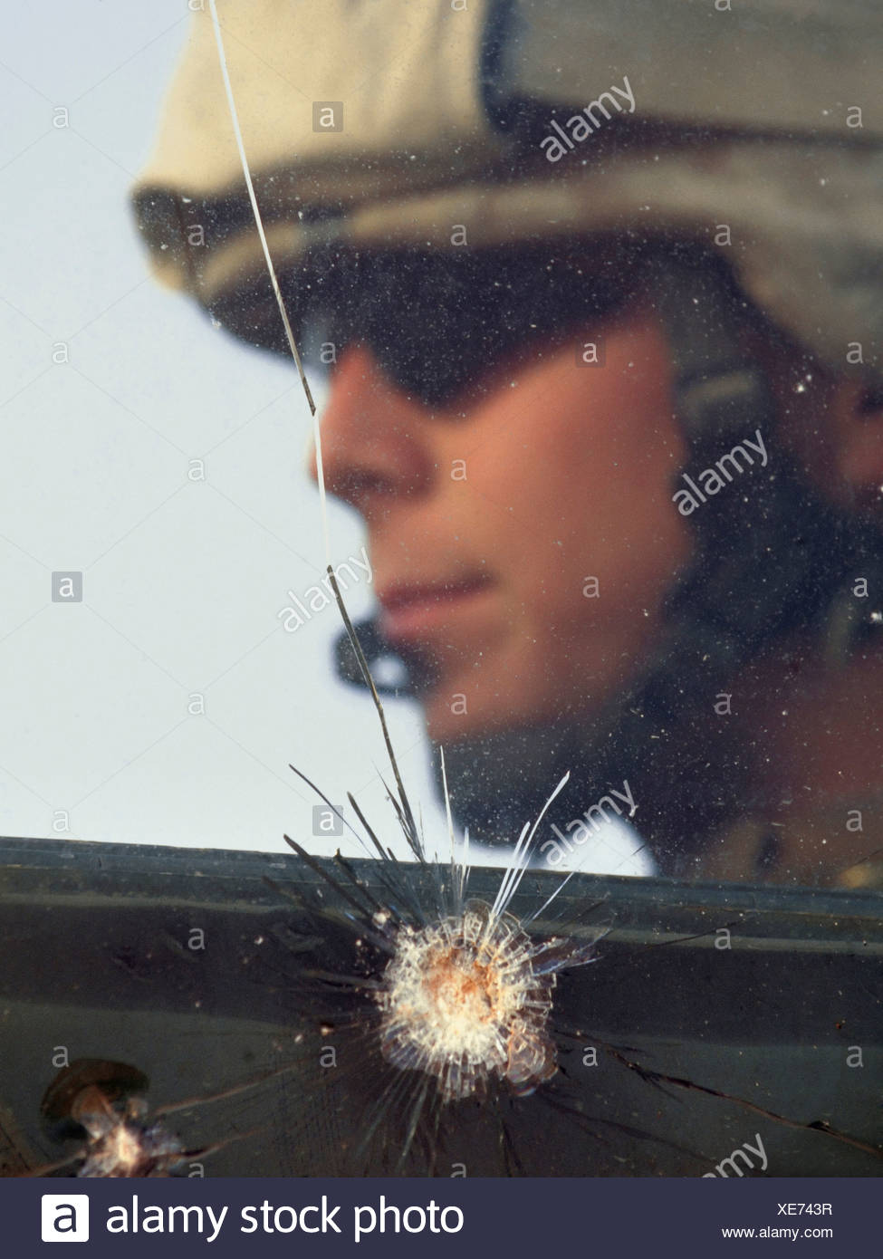 A US Marine Sits Behind Bullet Proof Glass That Was Recently Tested By a Machine Gun Round, Barwana, Iraq - Stock Image