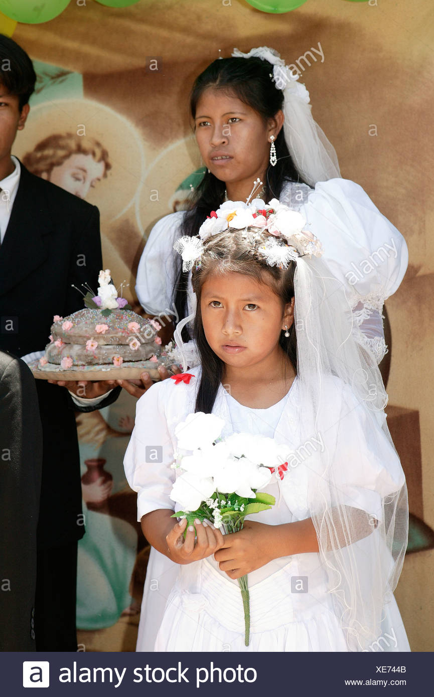 4282e529a9 Bride with wedding cake and flower girl