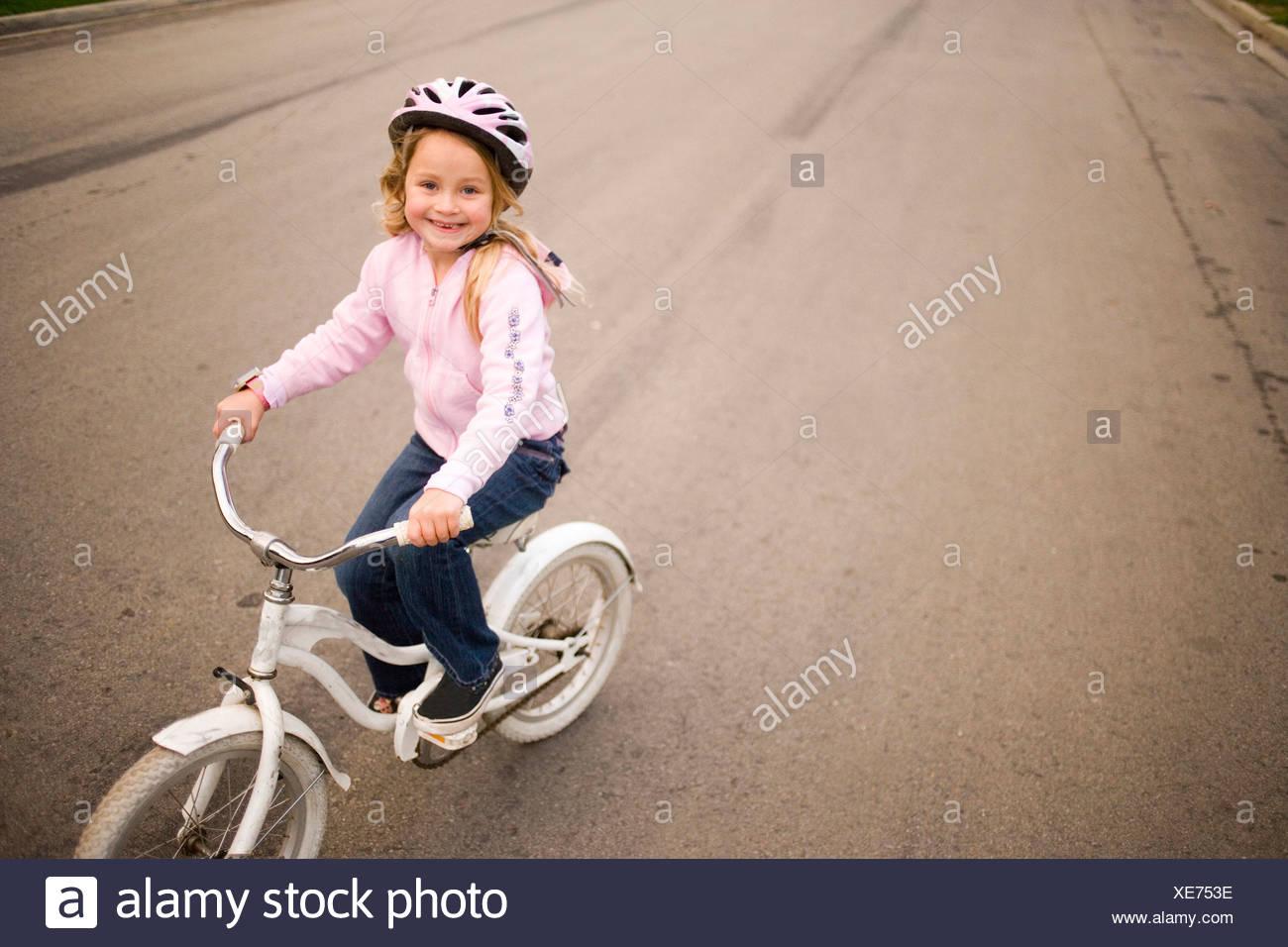 Girl riding bicycle - Stock Image