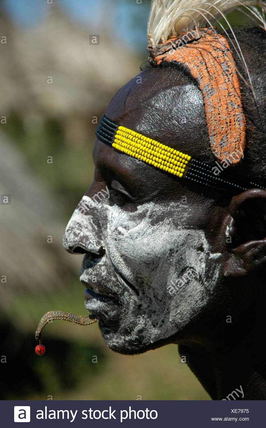 Karo chief with a white painted face, a clay headdress and colorful headband, profile portrait, Kolcho, South Omo Valley, Ethio - Stock Image