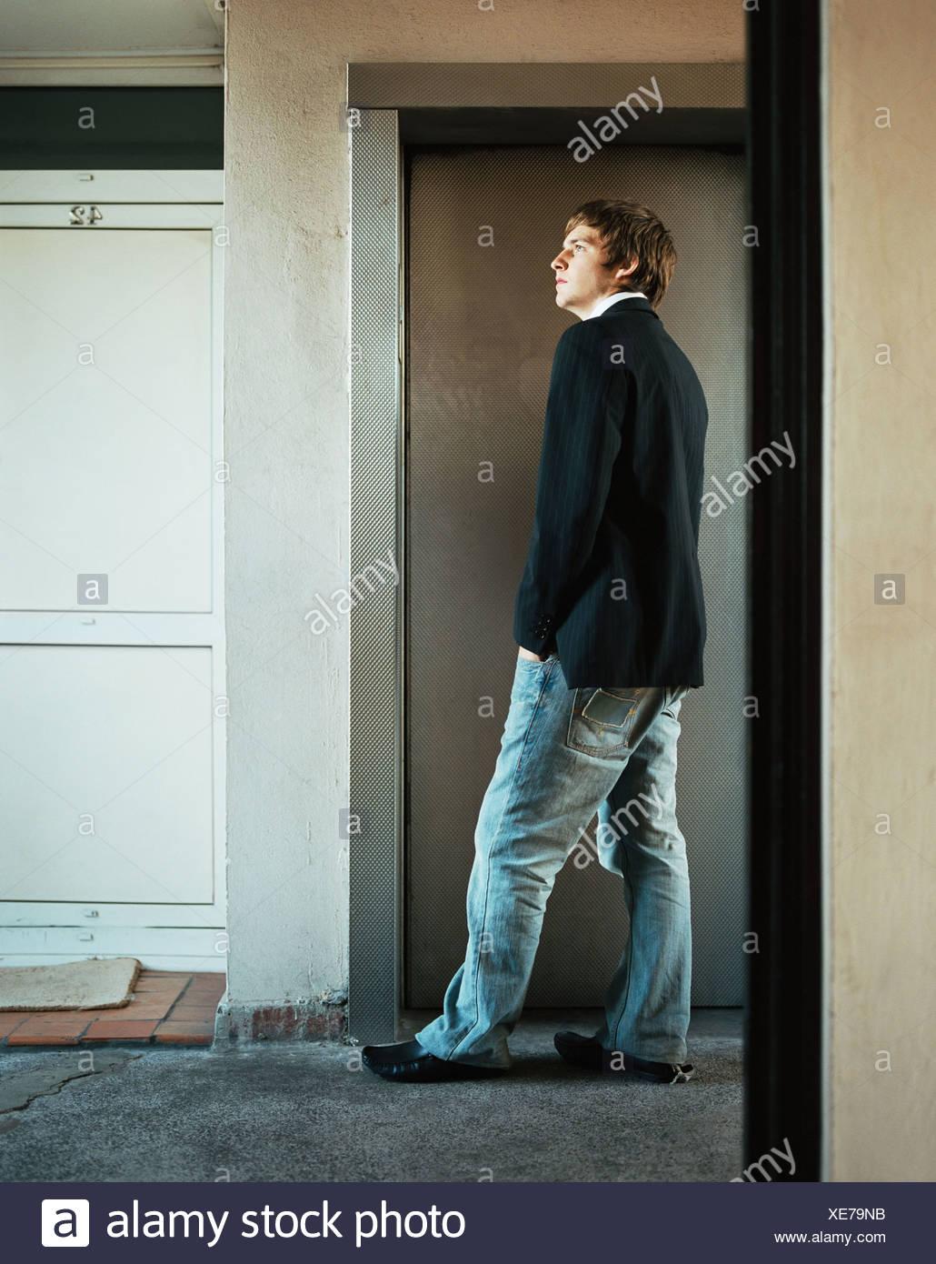 Stylish man waiting for elevator Stock Photo