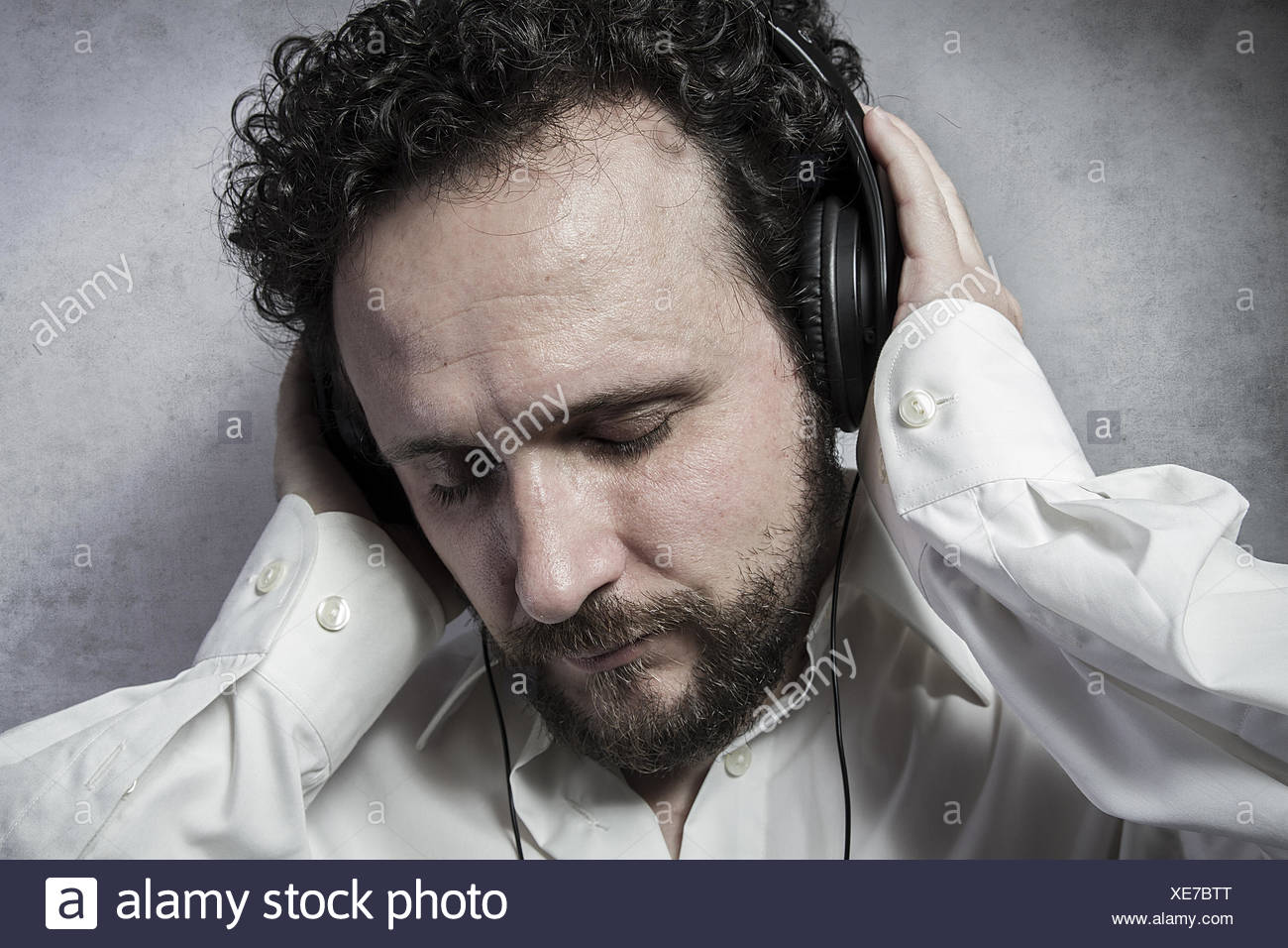 Listening And Enjoying Music With Headphones Man In White