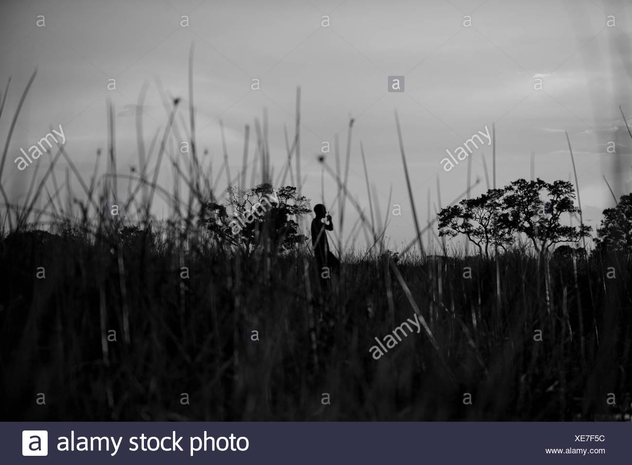 A man enjoys the sundown and the rest in the Okavango delta, Botswana - Stock Image