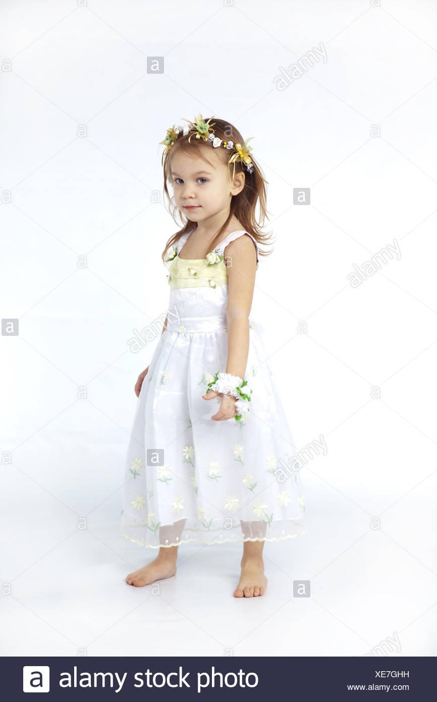 bfbdd271e2d Little girl in spring flower dress isolated on white background full-length