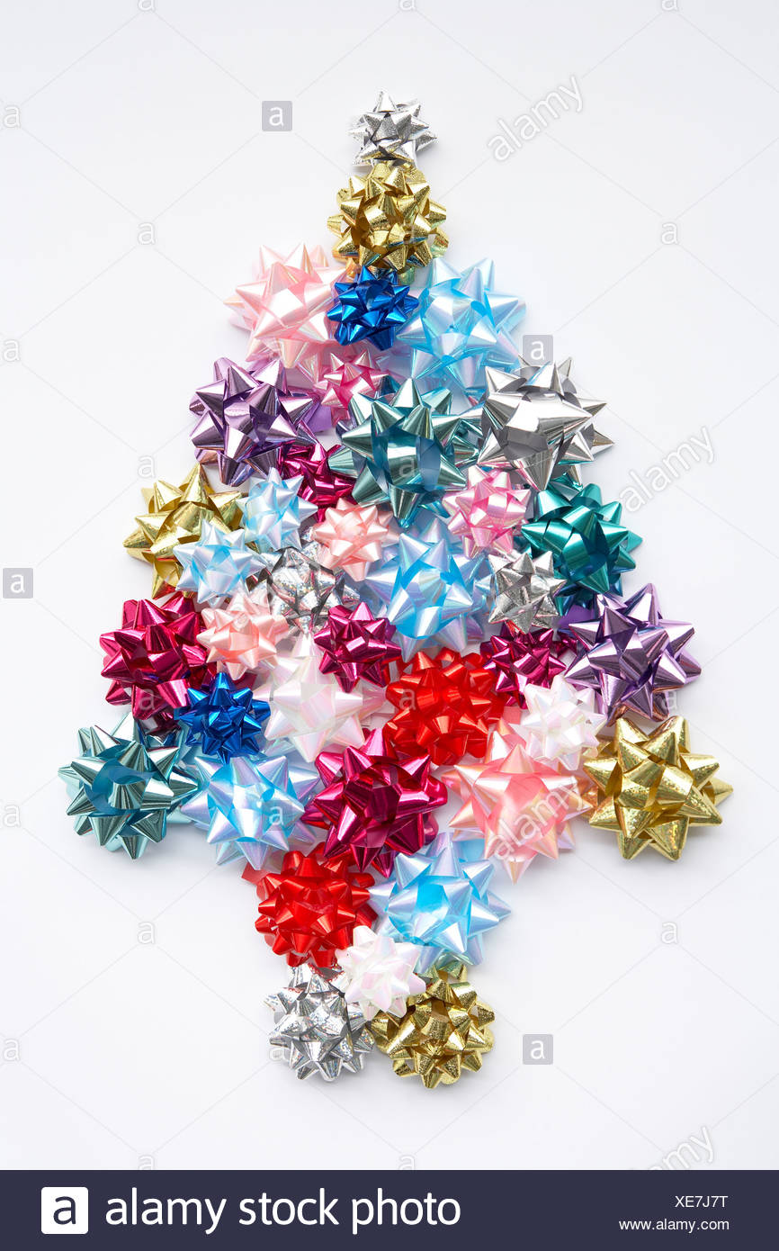 Christmas Tree Bows White.Christmas Tree Made From Gift Bows Against White Background