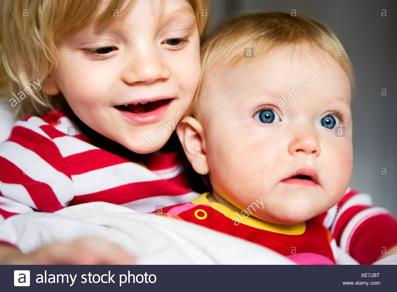 Brother and sister embracing - Stock Image