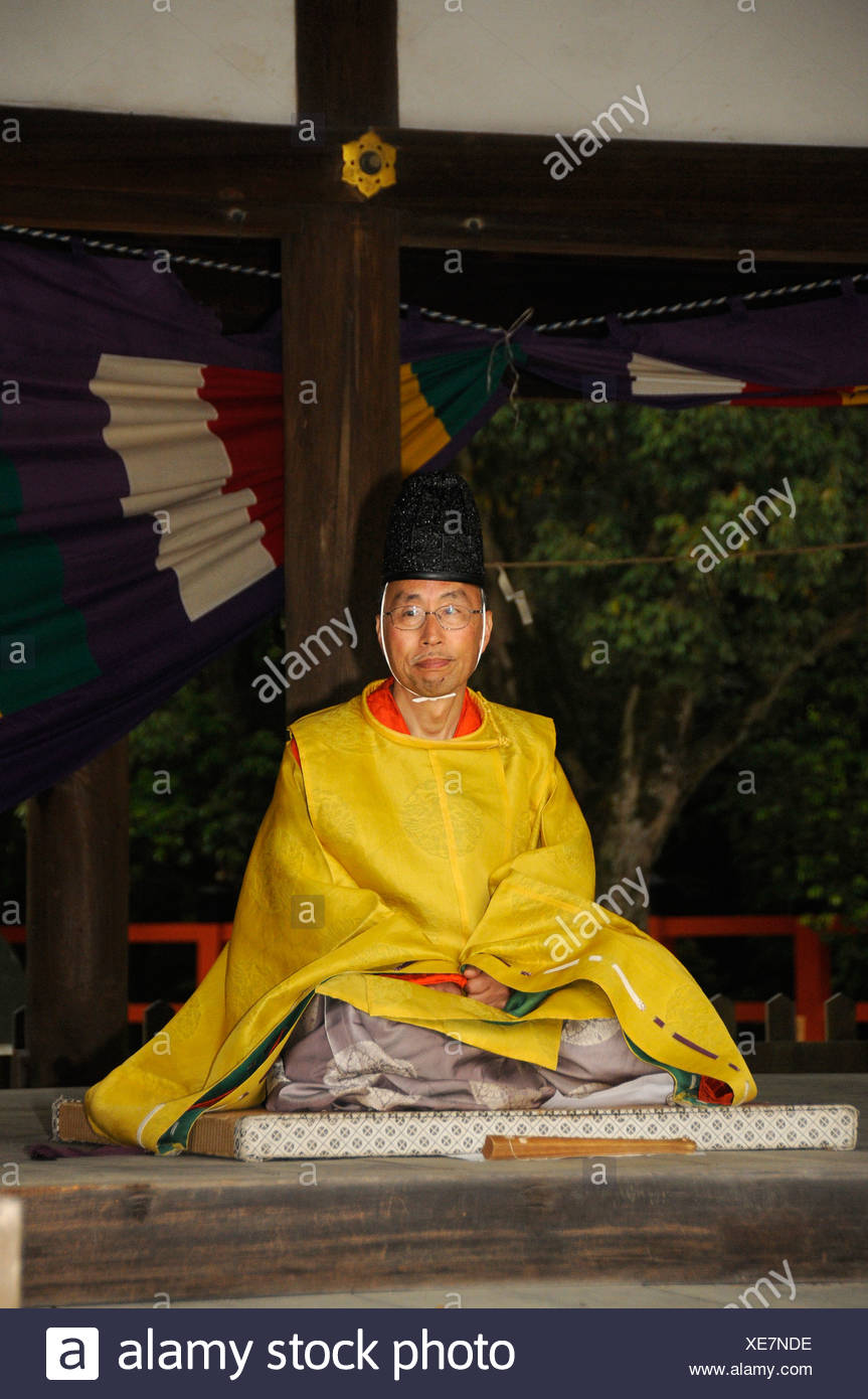 Priest watching the riders' contest from a shrine, equestrian festival at the Kamigamo Shinto Shrine, Kyoto, Japan - Stock Image
