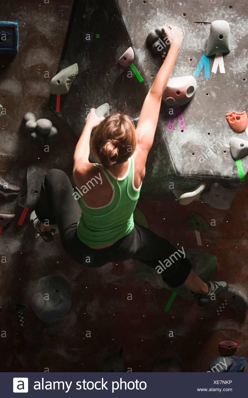 USA, Utah, Sandy, young woman on indoor climbing wall - Stock Image