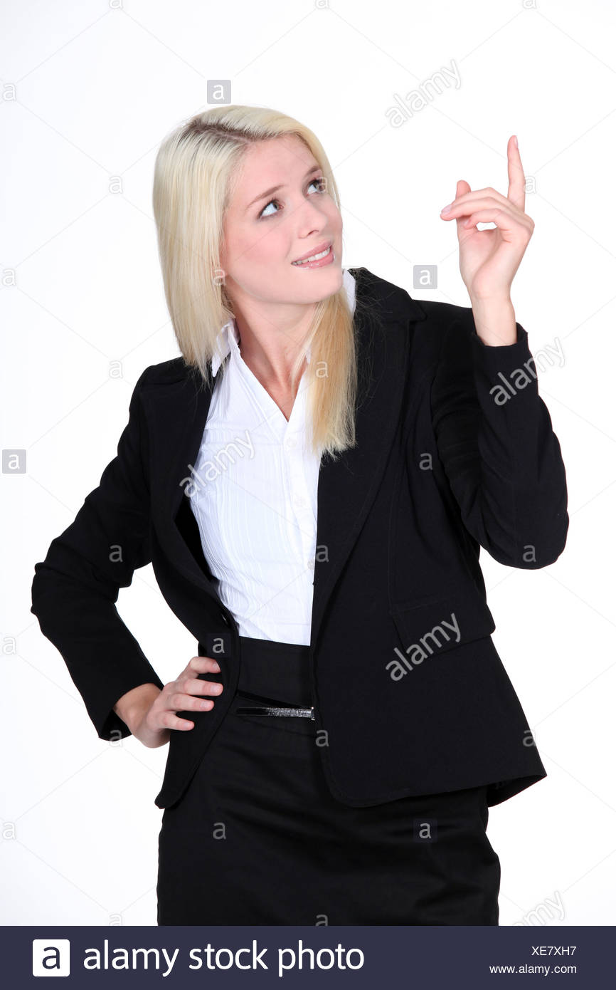 Businesswoman pointing her finger upwards Stock Photo