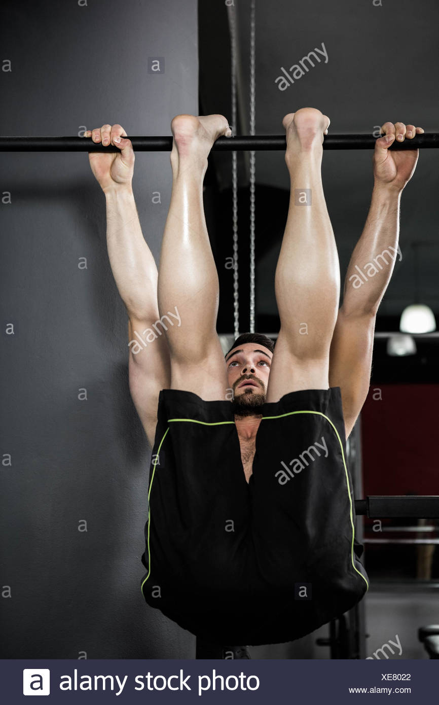 Shirtless man doing pull up Stock Photo