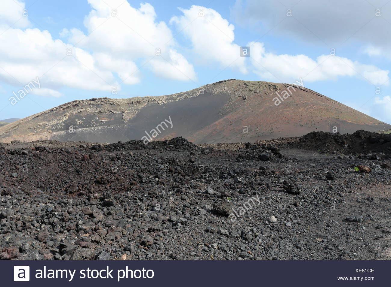 Spain, Lanzarote, Montana Colorada, lava bombs, lava field, mountains, scenery, rock, cliff, spectacle of nature, place of inter - Stock Image