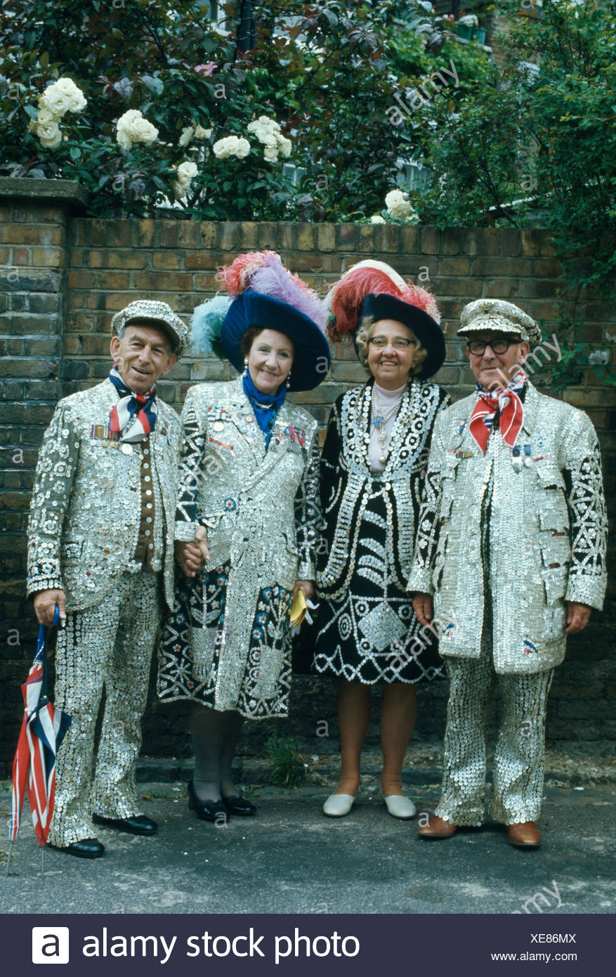 Pearly kings and queens showing their elaborate costumes - Stock Image