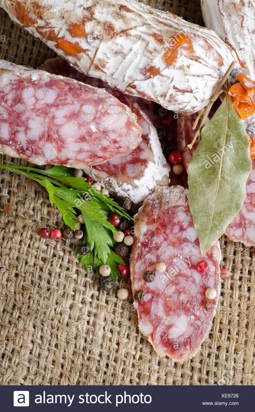 Salami sausage and spices in the tissue. - Stock Image