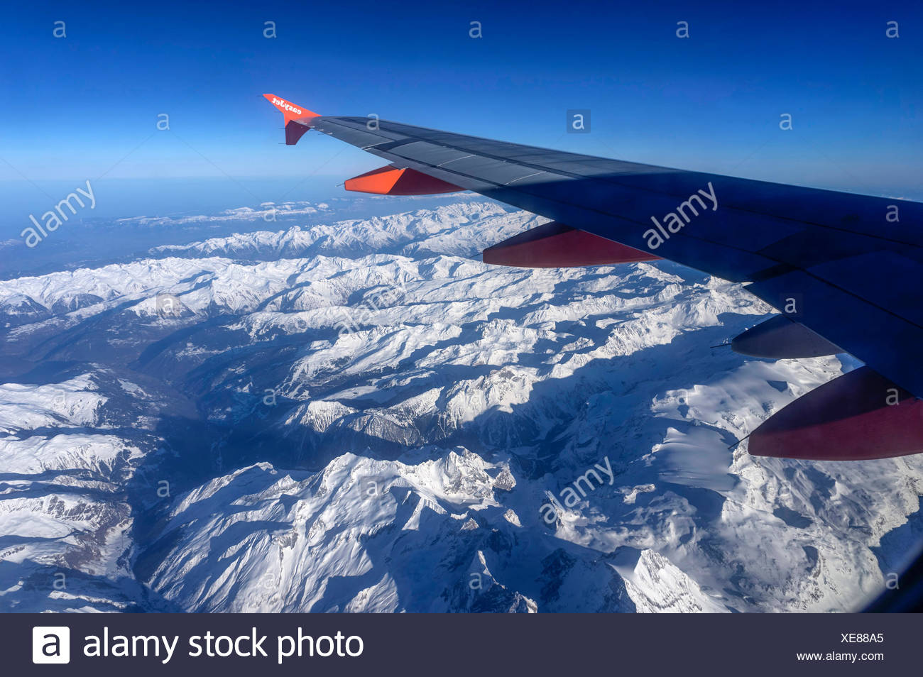 Aerial view from an aeroplane over the snowy Alps, Alps, Europe - Stock Image