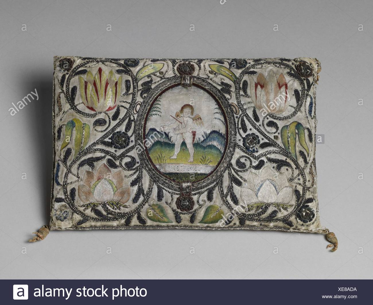 Cushion. Date: 1620-40; Culture: British or Dutch; Medium: Satin worked with silk and metal thread; satin, long-and-short, and couching stitches; - Stock Image