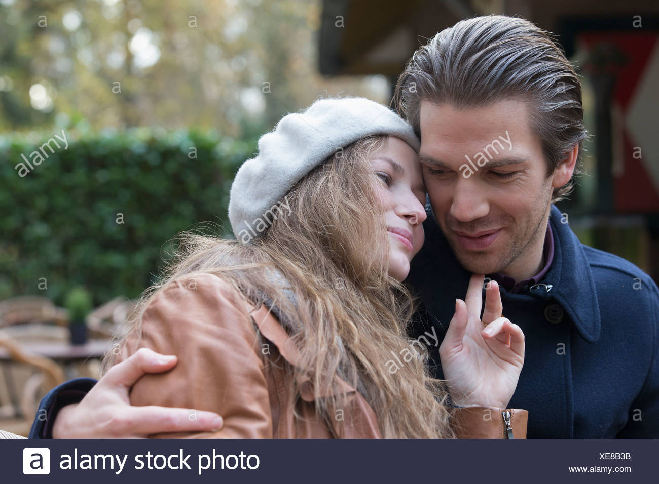 Couple hugging, arm around - Stock Image
