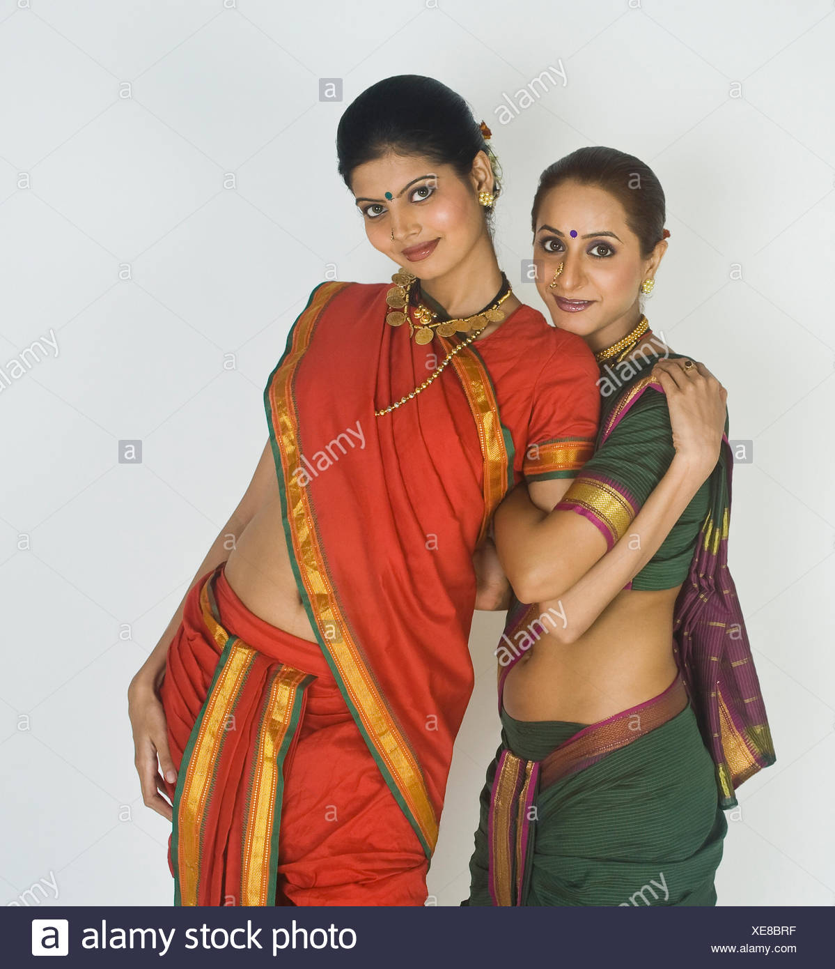 Portrait of two female folk dancers posing - Stock Image