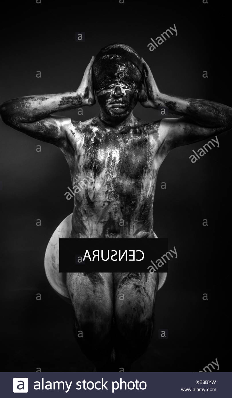 concept of censorship, blindfolded man covering his eyes, mouth and ears - Stock Image