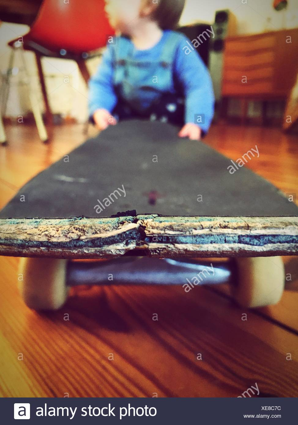 Baby Playing With Skateboard At Home - Stock Image