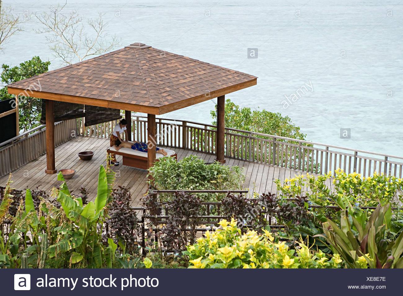 Woman having massage by ocean Stock Photo