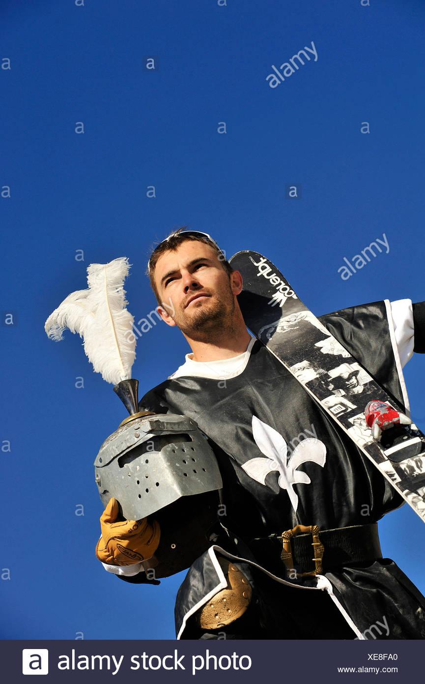 freeride skier disguised as knight - Stock Image