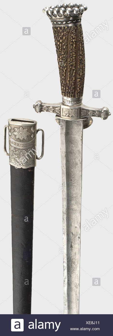A splendid hunting hanger with a silver hilt, J.H. Haussman, Vienna 1833 The fluted, single-edged blade is richly decorated with etched hunters and leaping deer. Heavy silver hilt with finely beaded staghorn grip scales, surmounted by a count's coronet. The quillons are decorated with chiselled leaves and another coronet. A large aristocratic coat of arms framed by acanthus leaves is screwed onto the guard plate. Leather scabbard with silver mountings made en suite. Viennese 1833 silver hallmark for 13 Lotige silver, and the master's mark 'I HH S' in a diamond , Additional-Rights-Clearences-NA - Stock Image