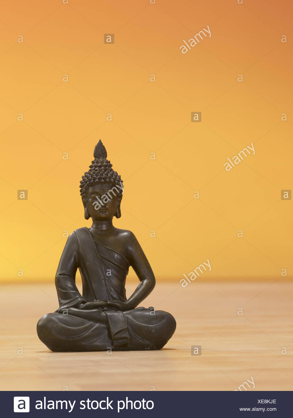 Indian Buddha's figure, lotus flowernsitz, figure, Buddha, Buddha's figure, Buddhism, meditation, concentration, yoga, wooden floor, sit, rest, Far Eastern, - Stock Image