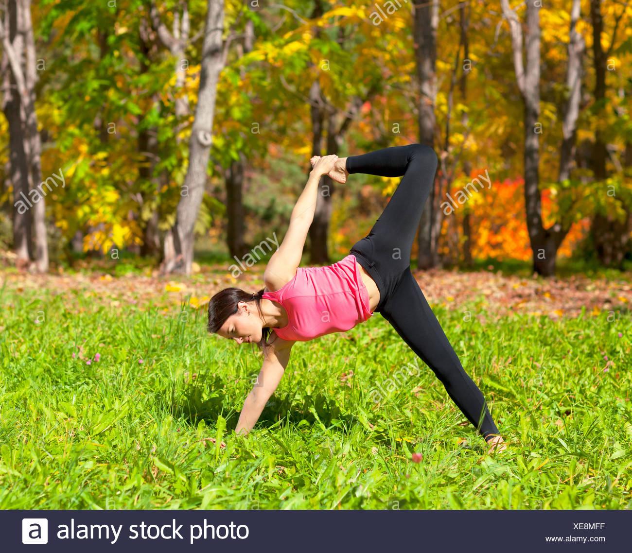 Yoga Ardha Chandra chapasana pose - Stock Image