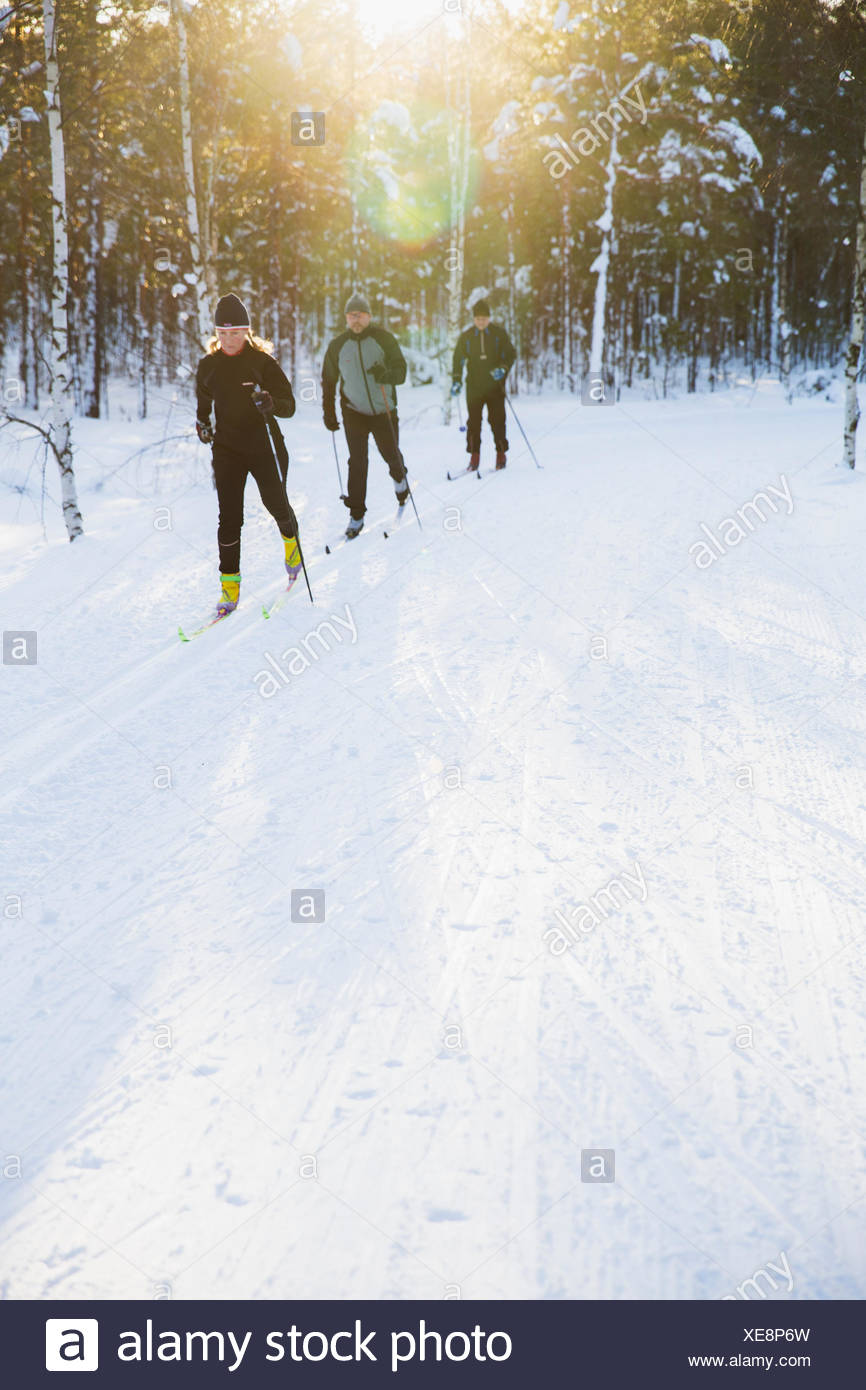 Sweden, Skiers outdoors in winter Stock Photo