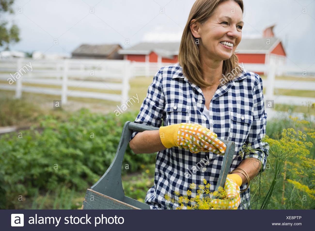 Woman standing in garden - Stock Image
