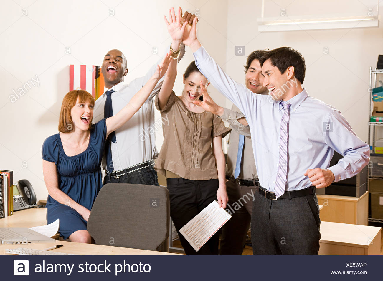 Office workers celebrating Stock Photo