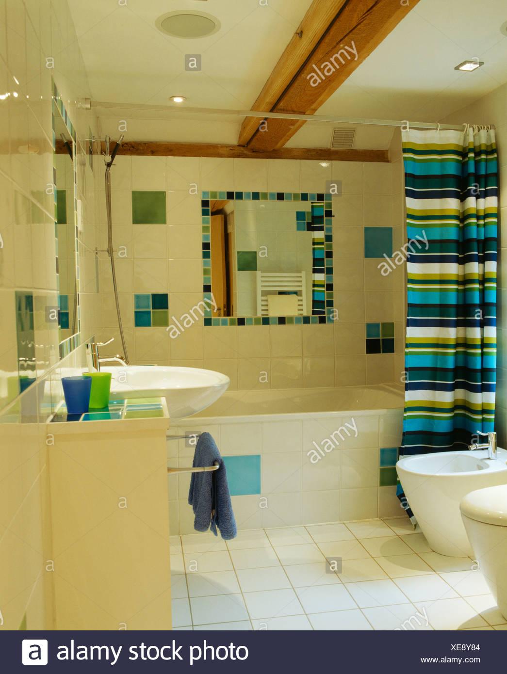 Brightly Striped Shower Curtain On Bath In Modern Bathroom