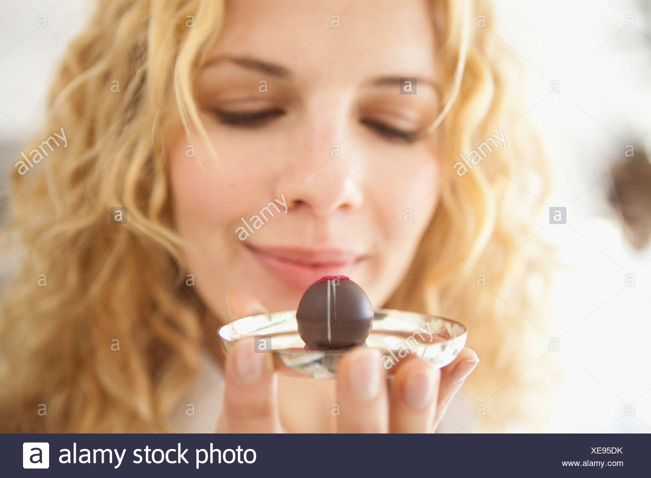 A woman holding at a chocolate - Stock Image