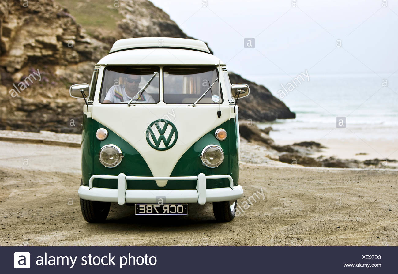 Green VW campervan on beach, St Agnes, Cornwall, UK - Stock Image
