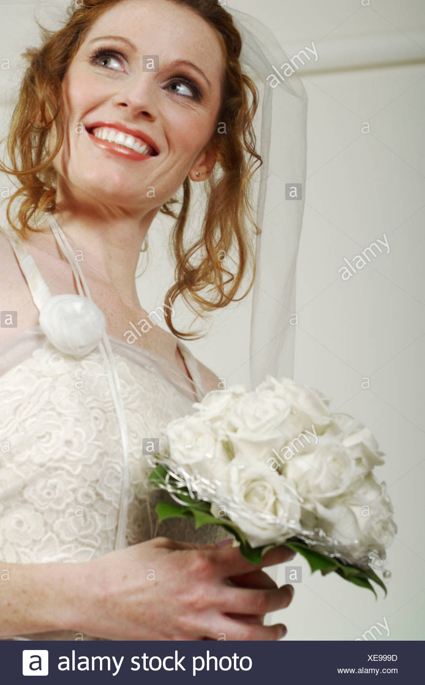 Bride with white bridal bouquet Stock Photo