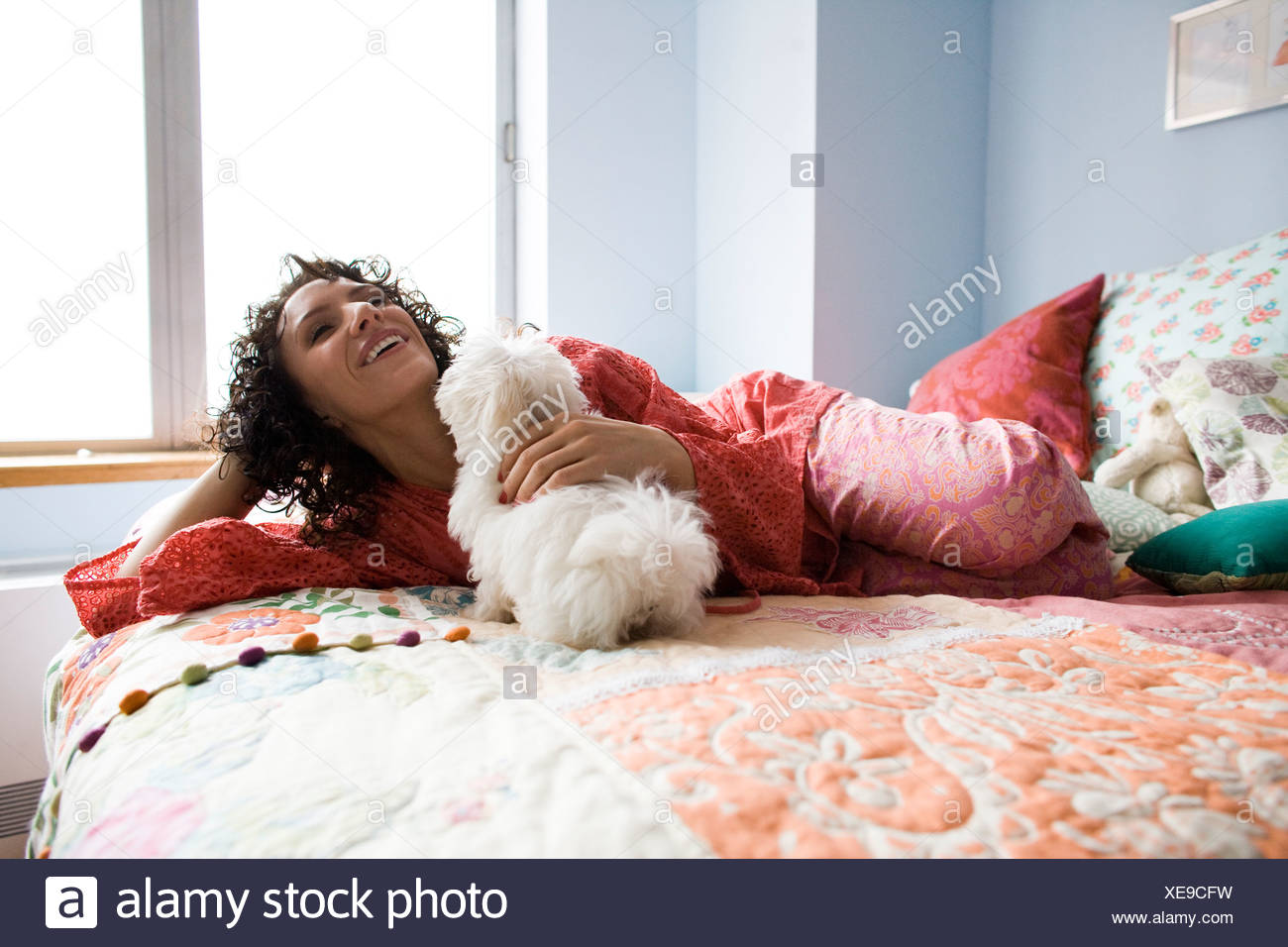 woman lying on a bed - Stock Image